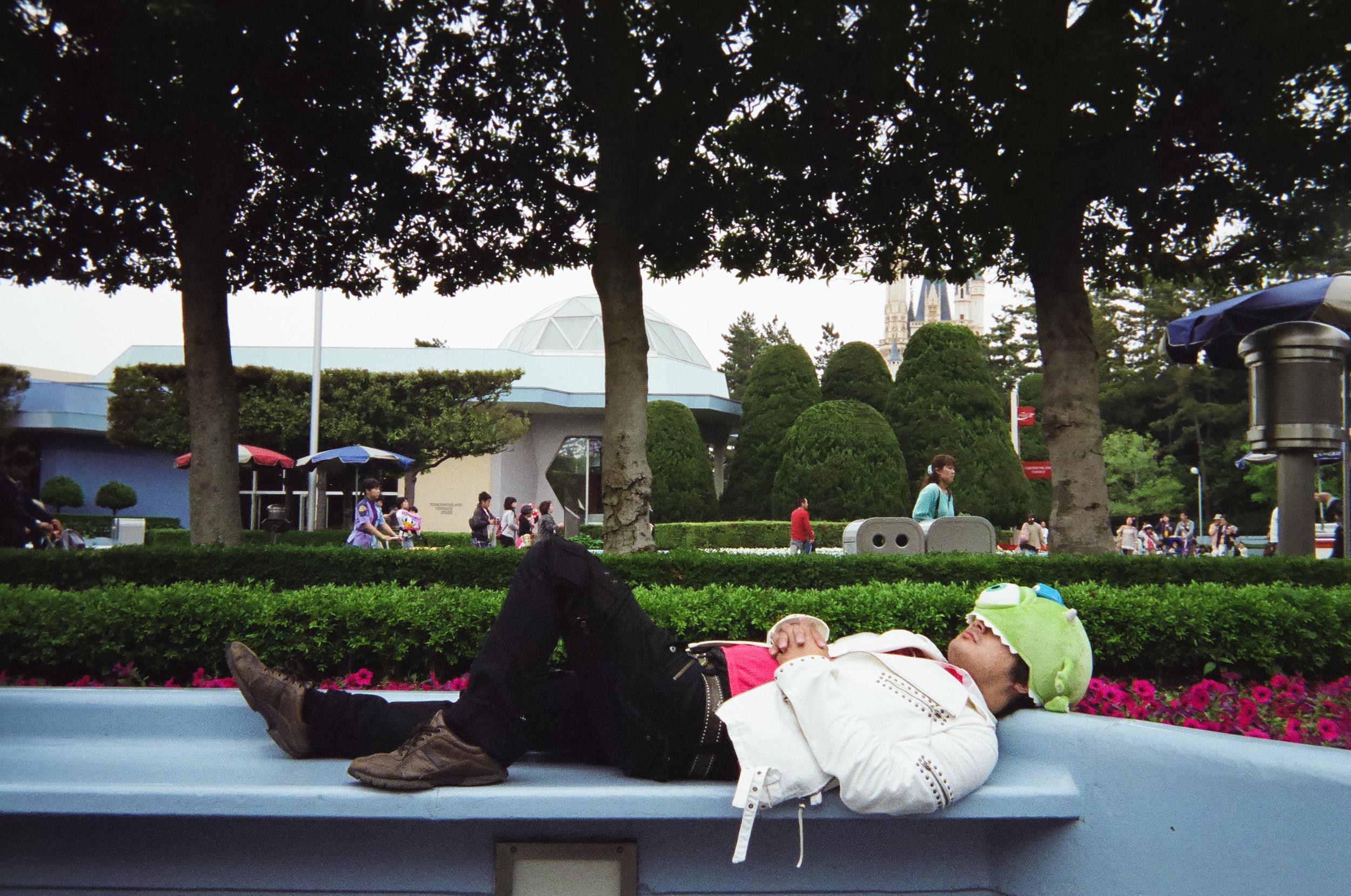 Taking a nap at Disneyland, Tokyo