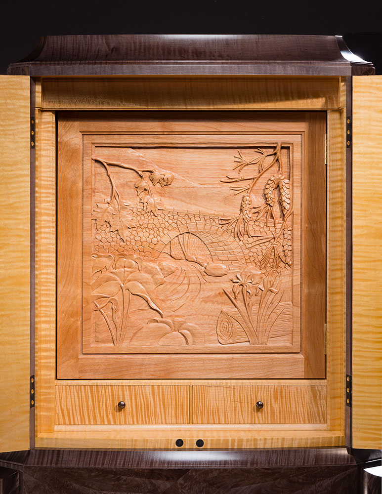 Acadia cabinet carving