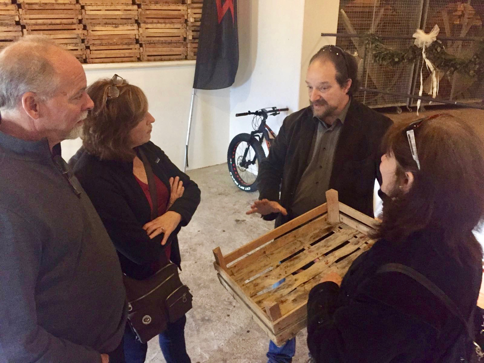 Introducing the appassimento in small wooden boxes - photo courtesy of tenuta santa maria valverde