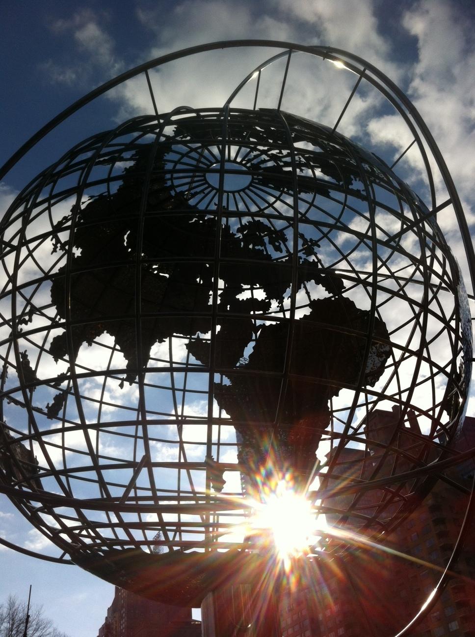 Winter sun streams through the globe in Columbus Circle.