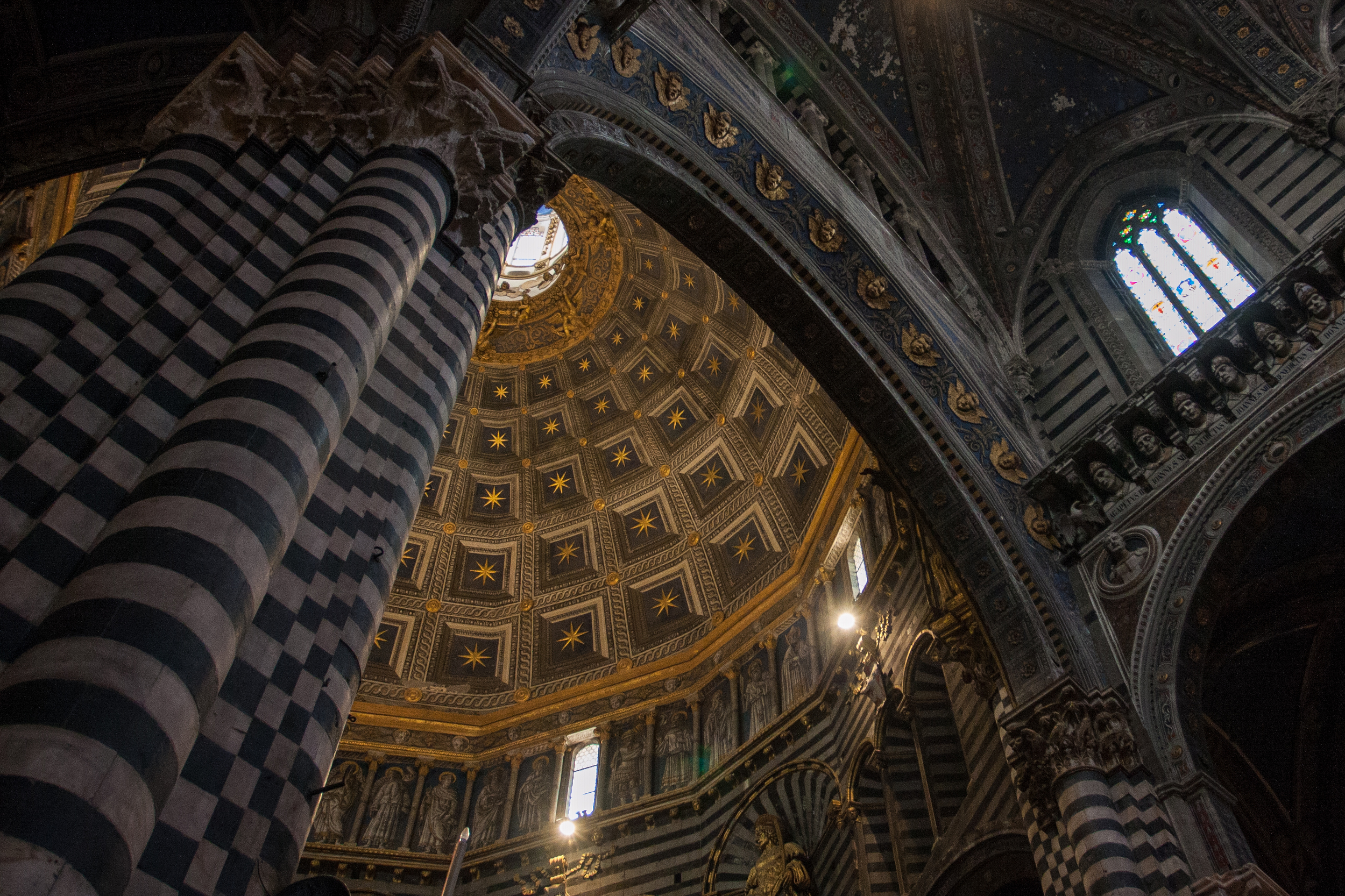Looking up at the dizzying architecture of the Duomo's interior.