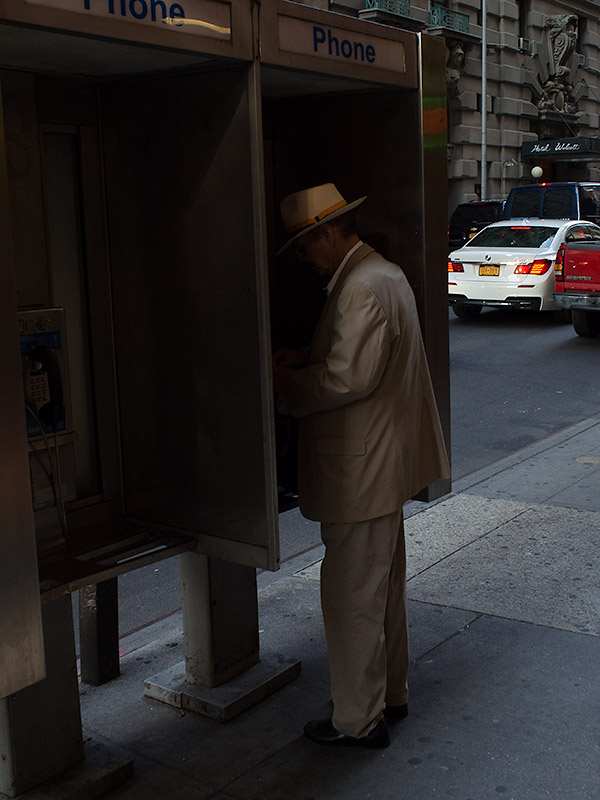 Mysterious figure at a phone booth.