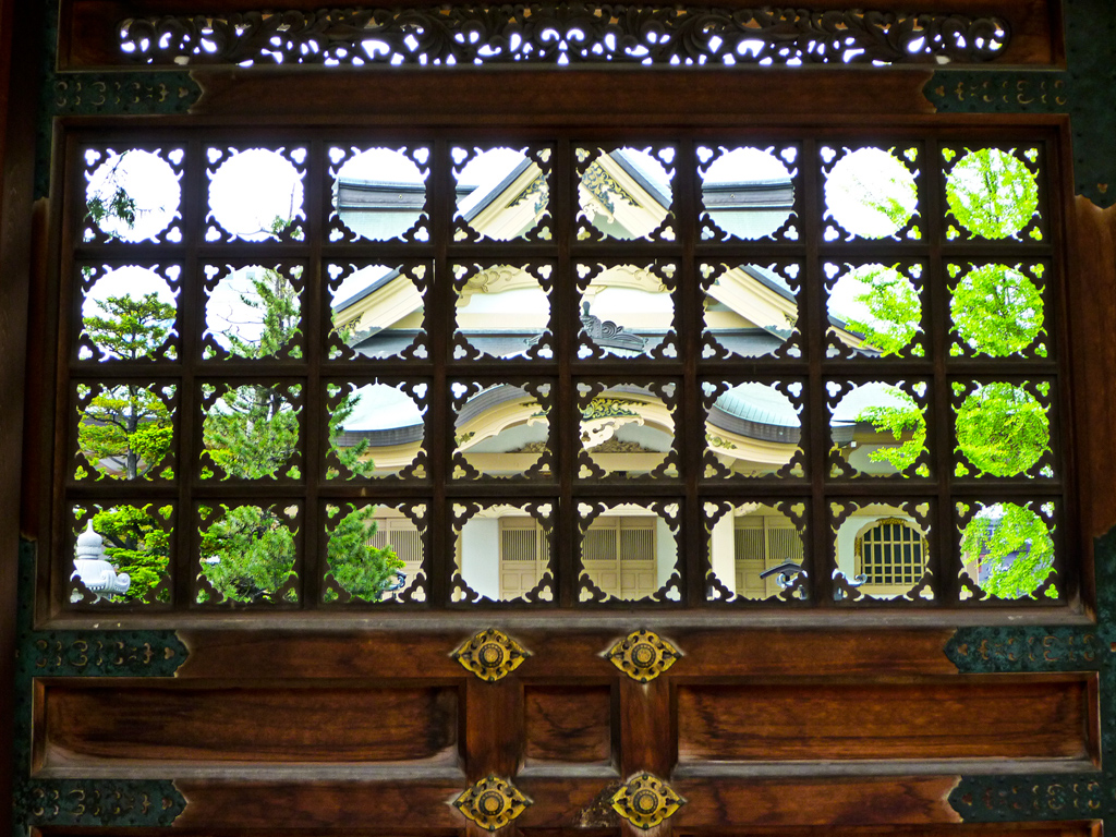 The Temple through a screen in one of the doors