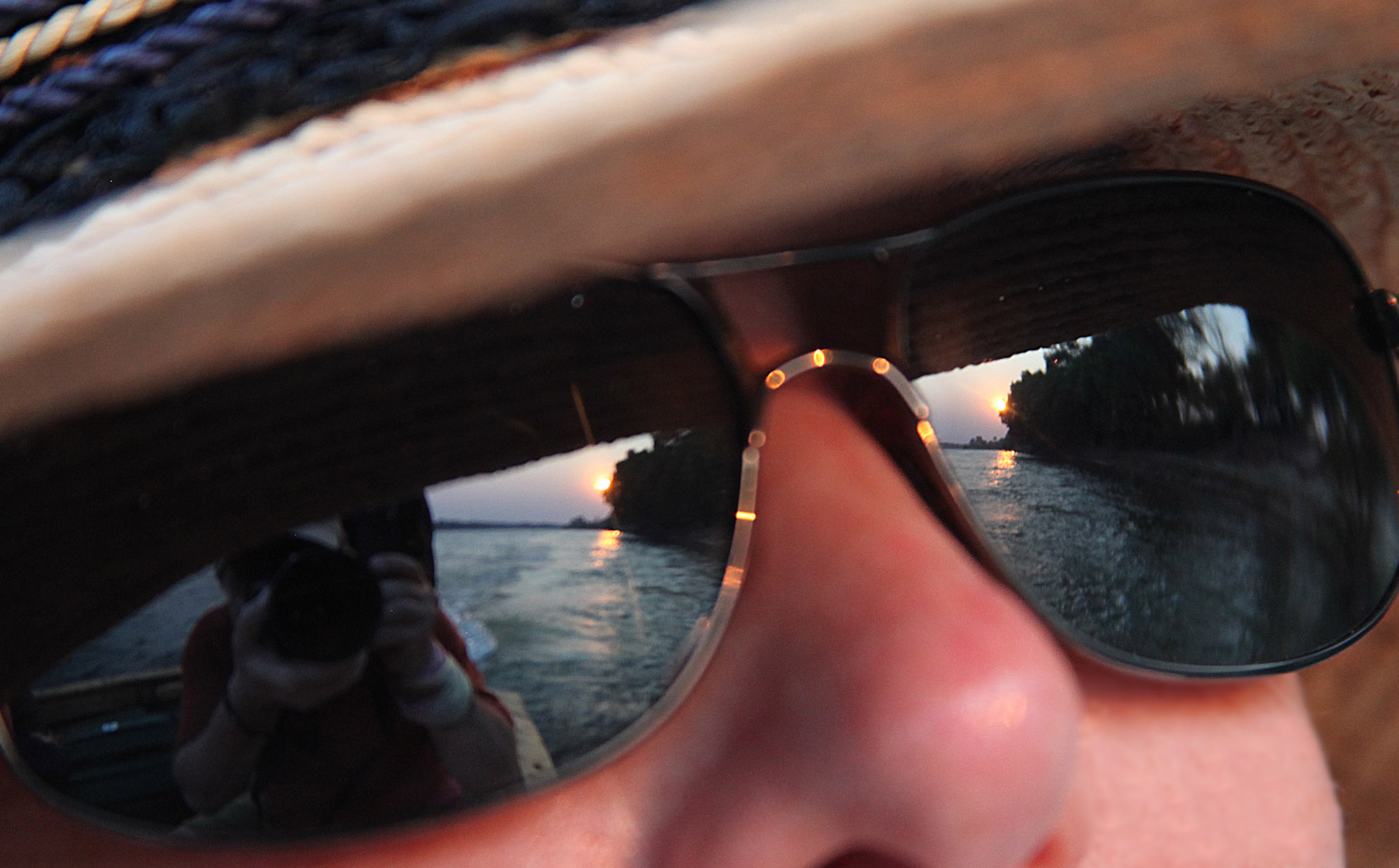 Zambesi sunset reflected in Kelly's sunglasses