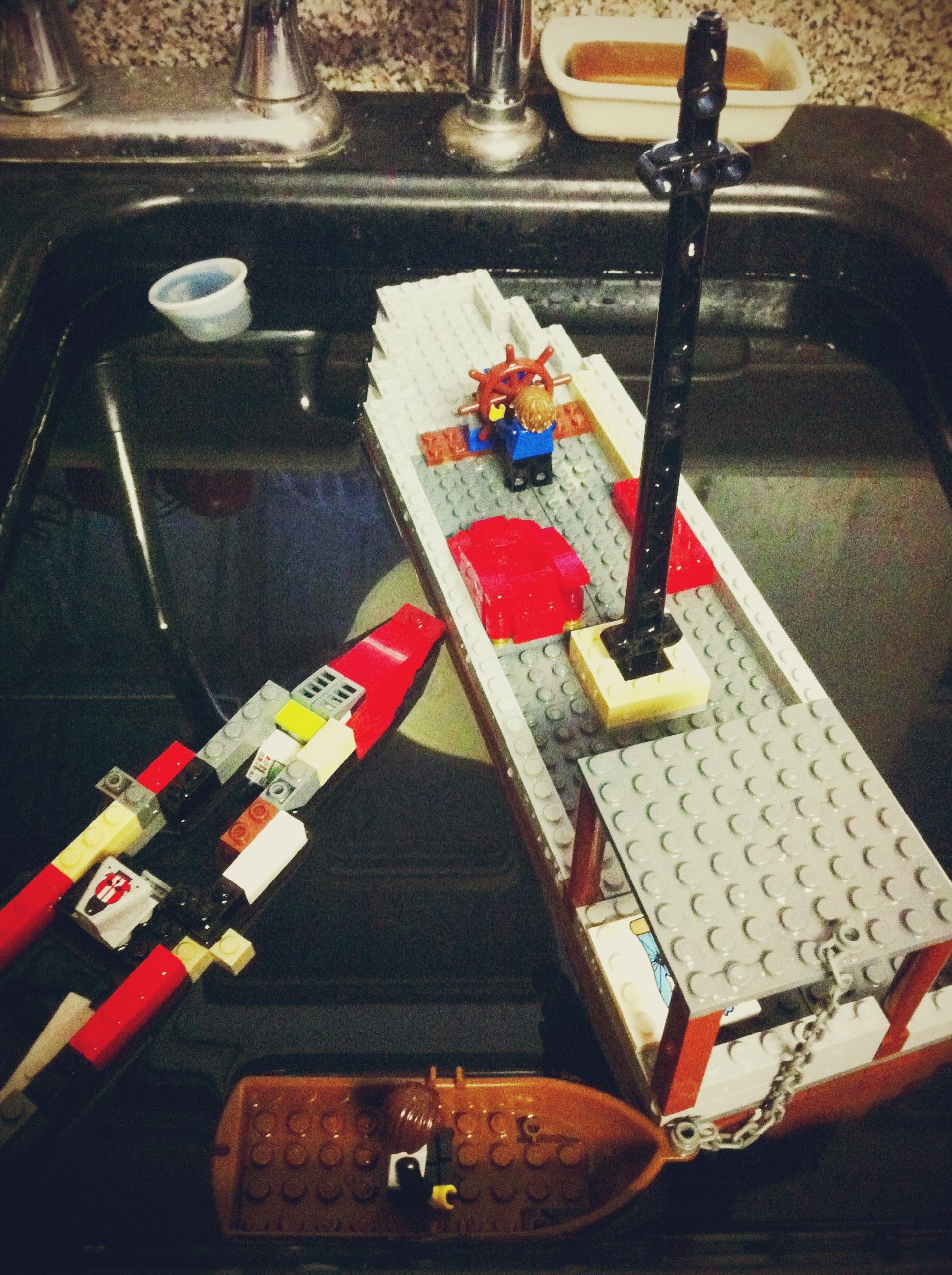 Lego ships in the kitchen sink.JPG
