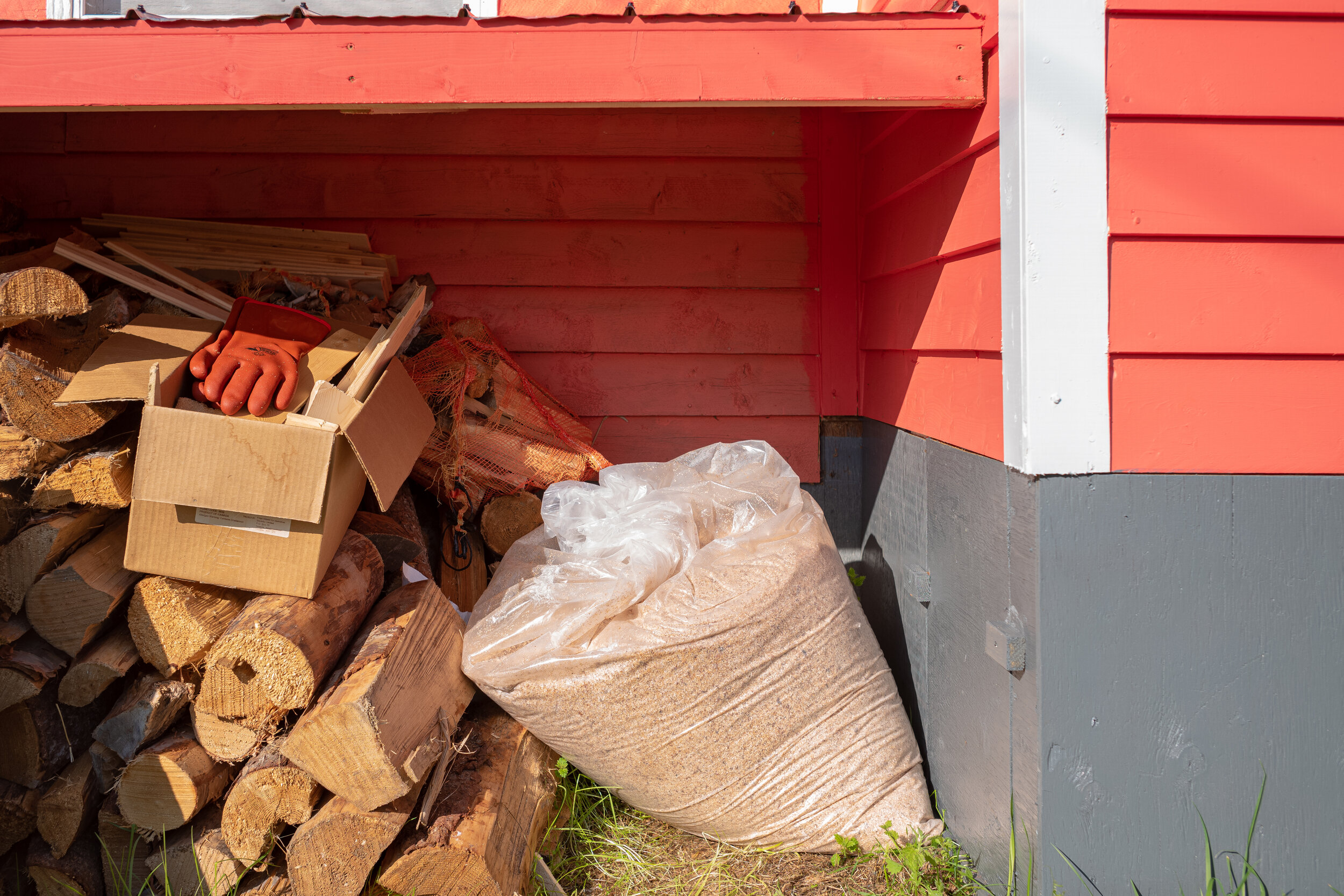 """The sawdust used in the privy. To the right of the bag is a little door that when open provides access to the """"box"""""""