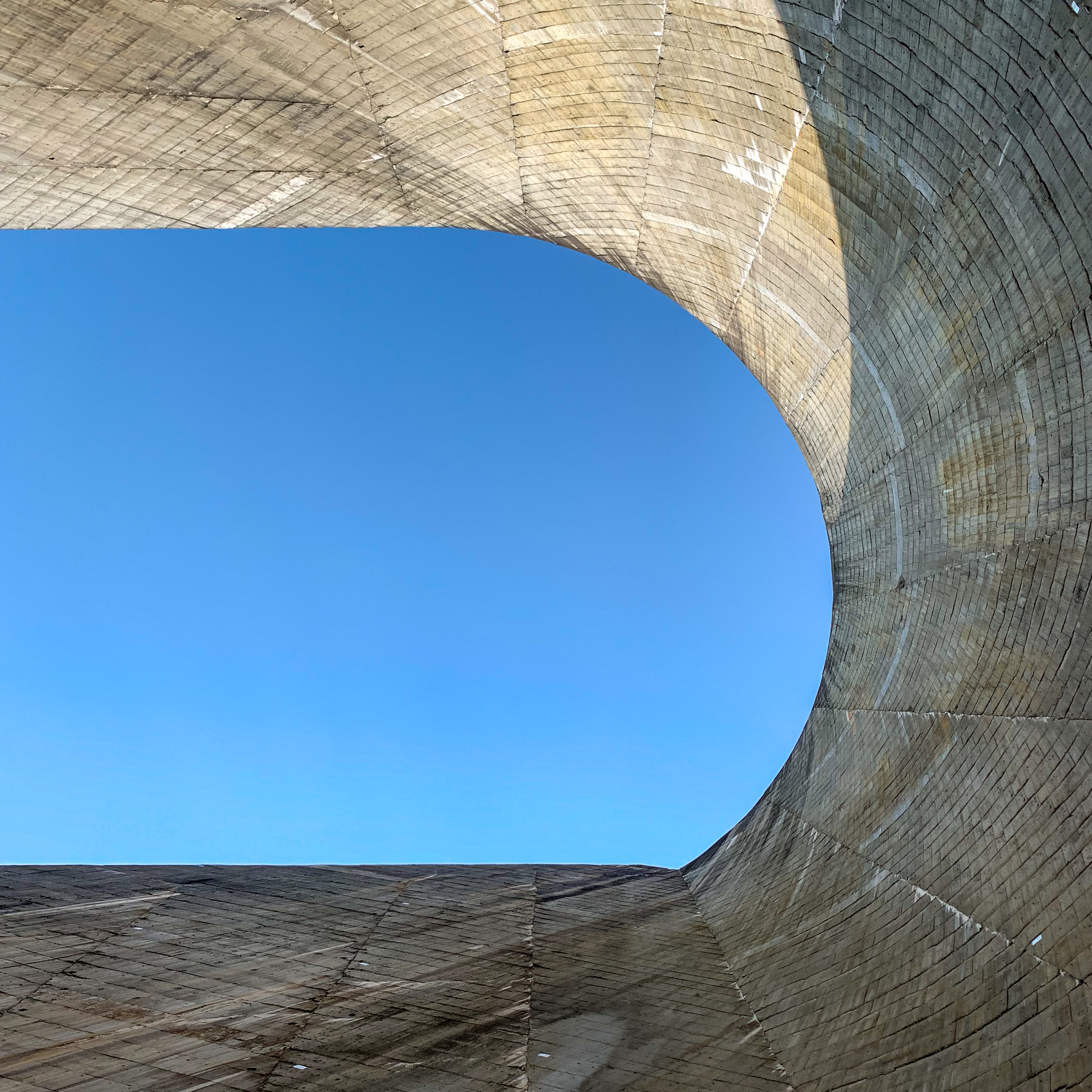 Standing at the base and looking up at Daniel Johnson Dam.