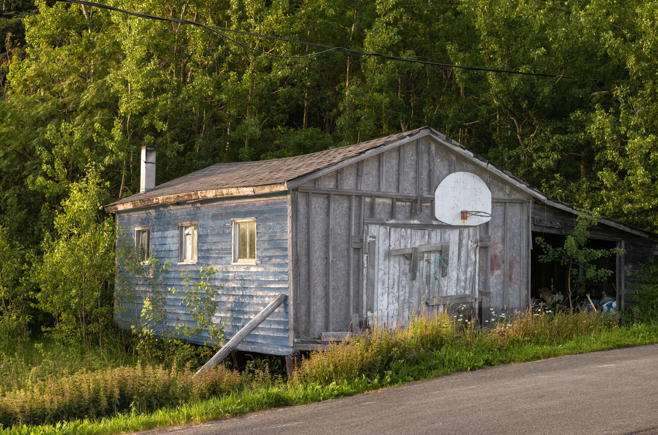 Garage with basket ball hoop.