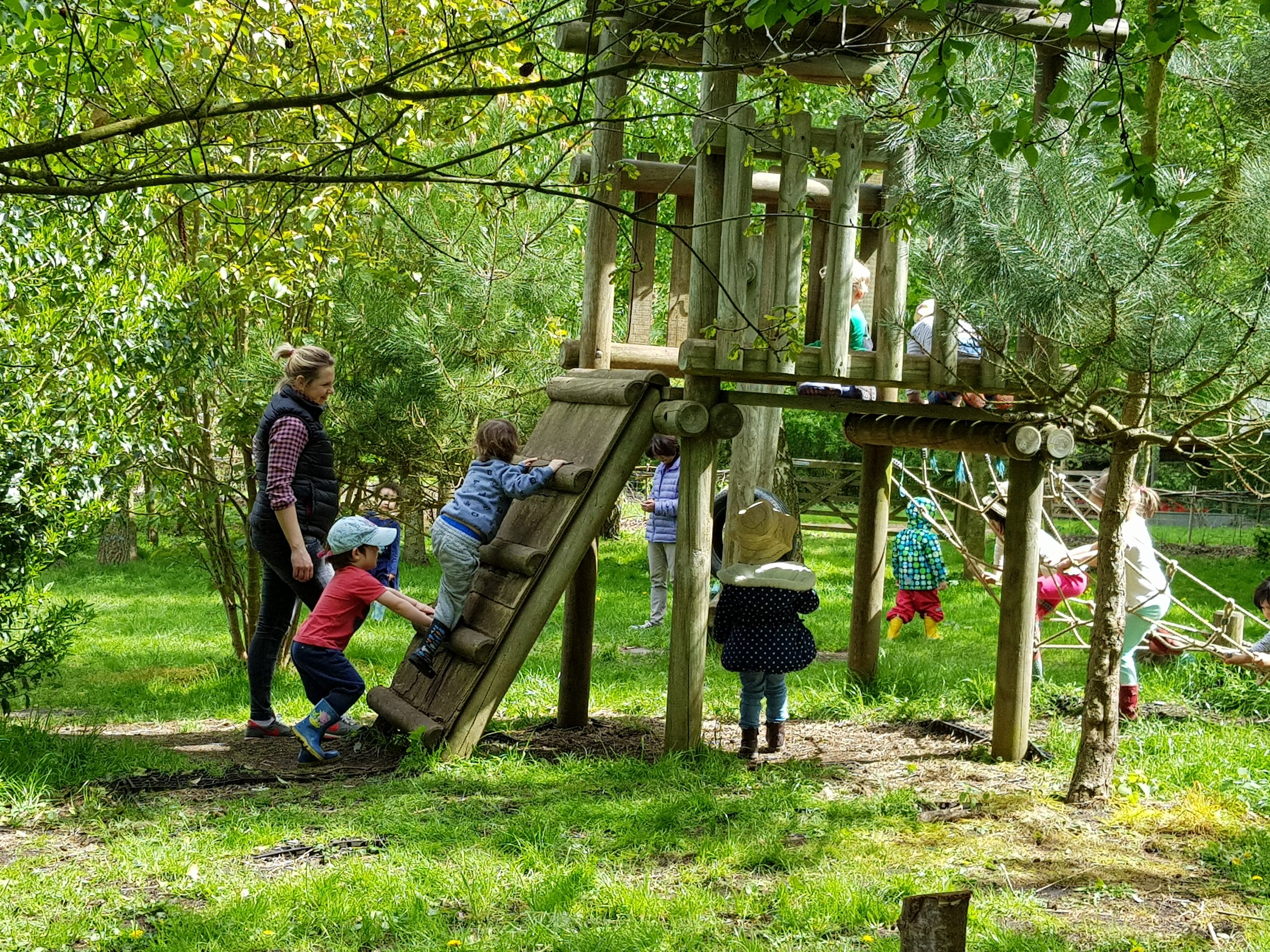 Nursery children have access to playgrounds near our woods.