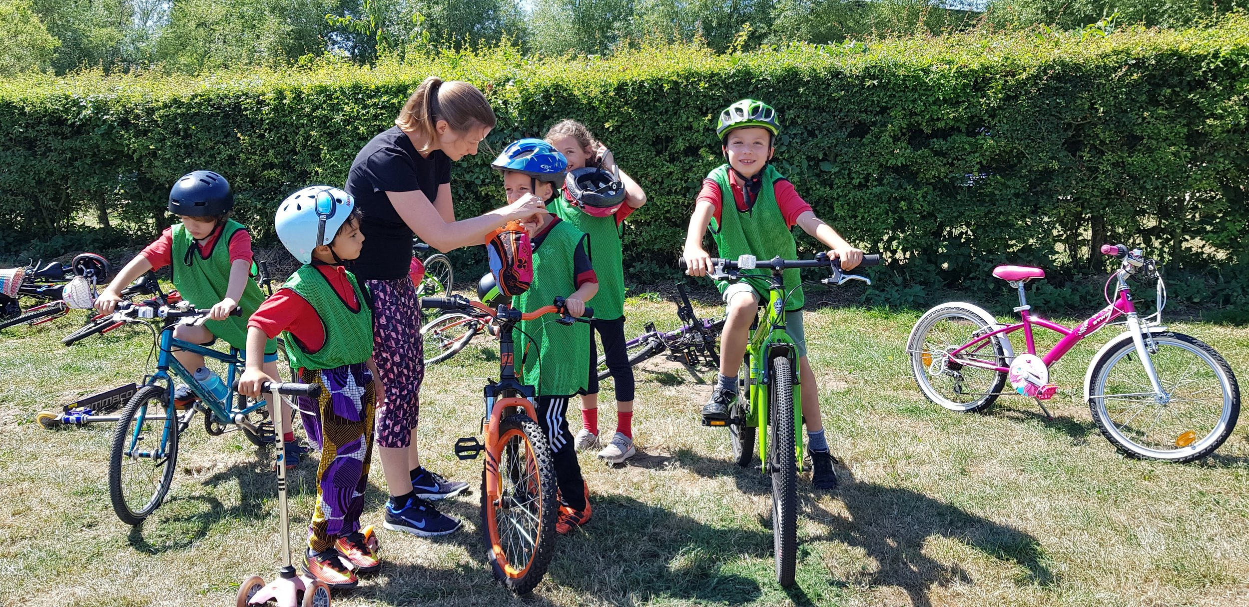 Primary aged children bike riding during sports day