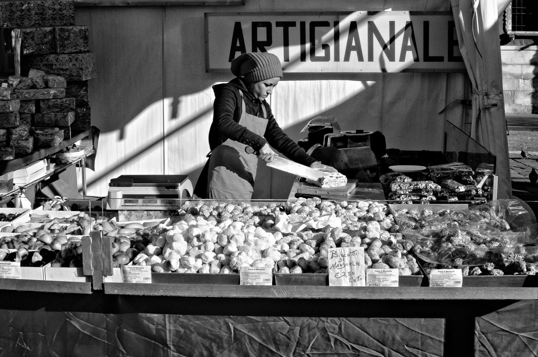 Woman Cutting Torrone