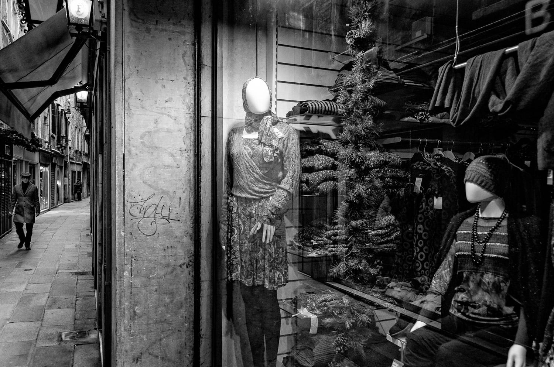 Shop Window & Approaching Man