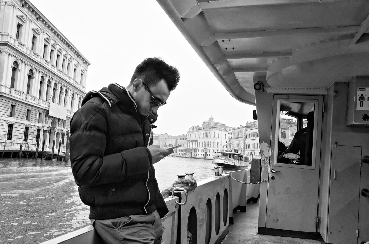 Man on Vaporetto with Phone