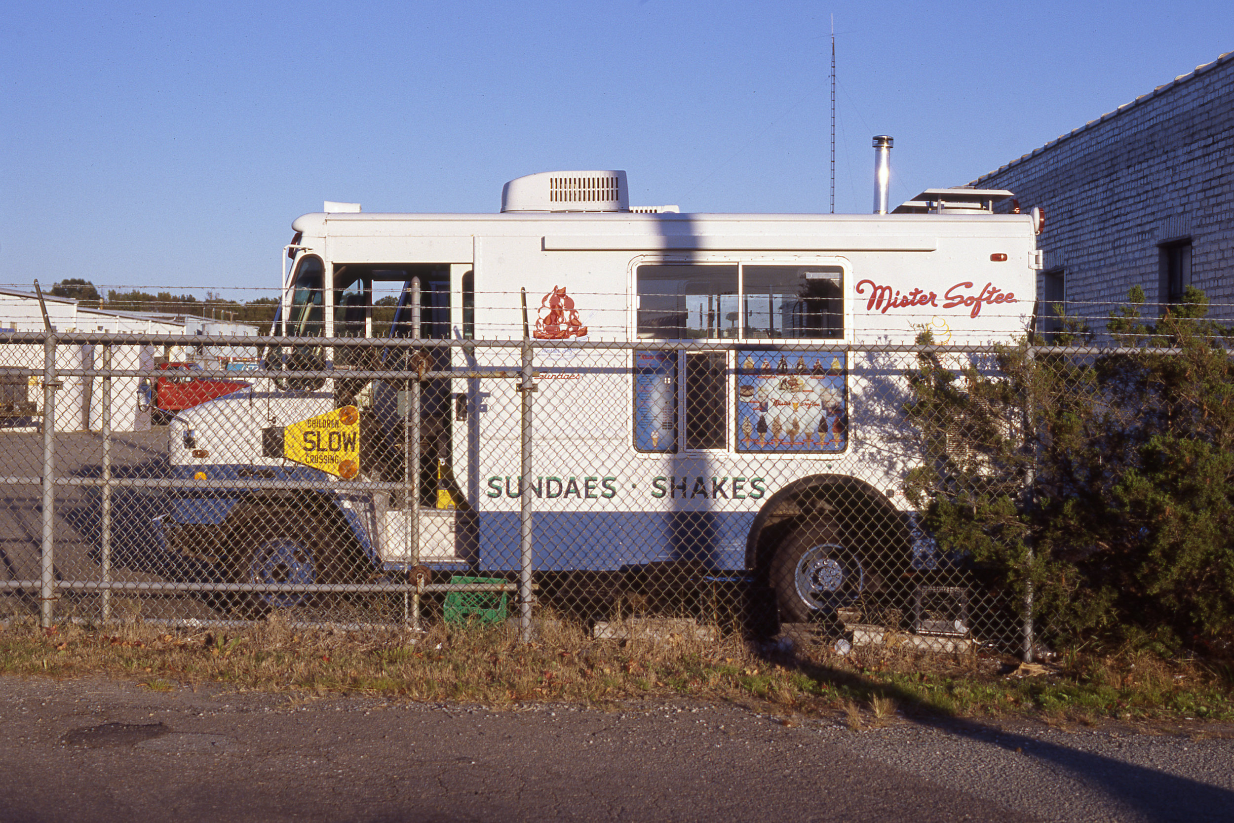 A well-protected Mister Softee truck photographed during the golden hour on Kodak's new Ektachrome E100 slide film.