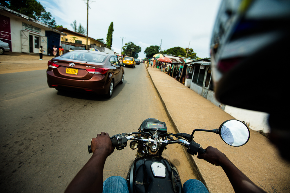 Monrovia, Liberia - November 13, 2013: Now that pehn-pehns are banned from driving in the city, drivers are making 400 LD a day or less. They don't have money to pay their rent, school fees, or parking for their bikes.  Photo by Morgana Wingard