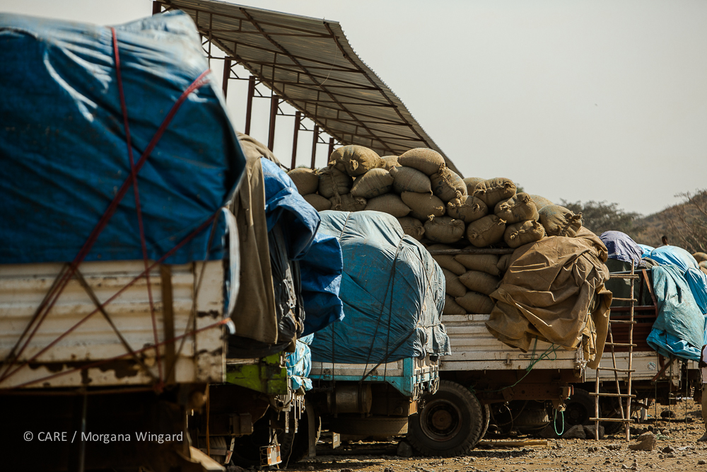 Awassa, Ethiopia - Jan 22, 2014:   Trucks filled with bags of coffee are waiting in this compound to be inspected. A sample from every bag will be tasted to grade the quality before it is accepted into the warehouse.