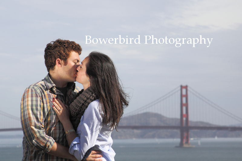 A romantic San Francisco postcard - a beautiful couple kissing in front of the Golden Gate Bride. © Bowerbird Photography 2012; Engagement Photography at Lands End, San Francisco.