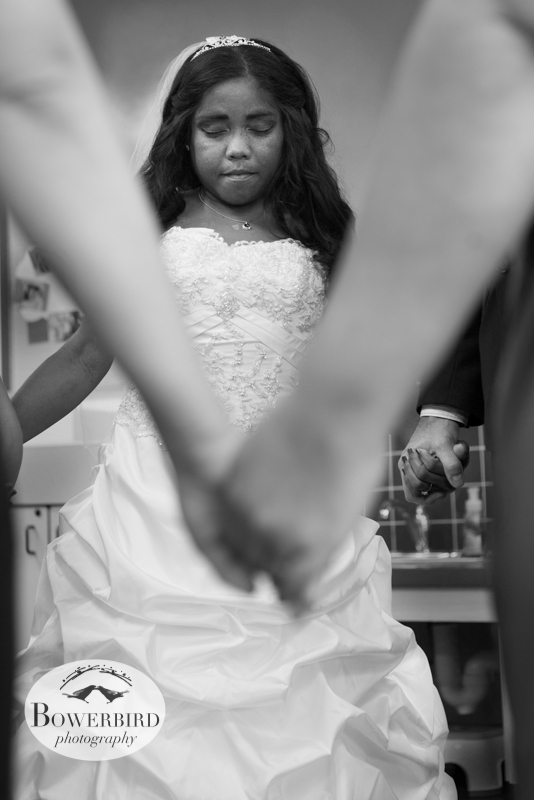 The bride stops for a moment of prayer before the wedding ceremony.© Bowerbird Photography 2012; Wedding Photography in Dublin, CA.