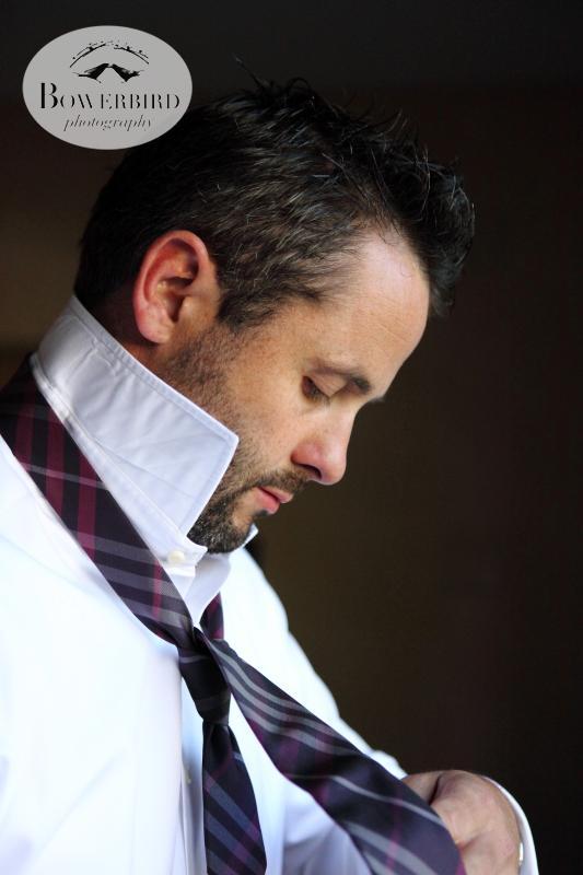 The groom putting on his tie. ©Bowerbird Photography 2013; St. Ignatius Church Wedding, San Francisco.