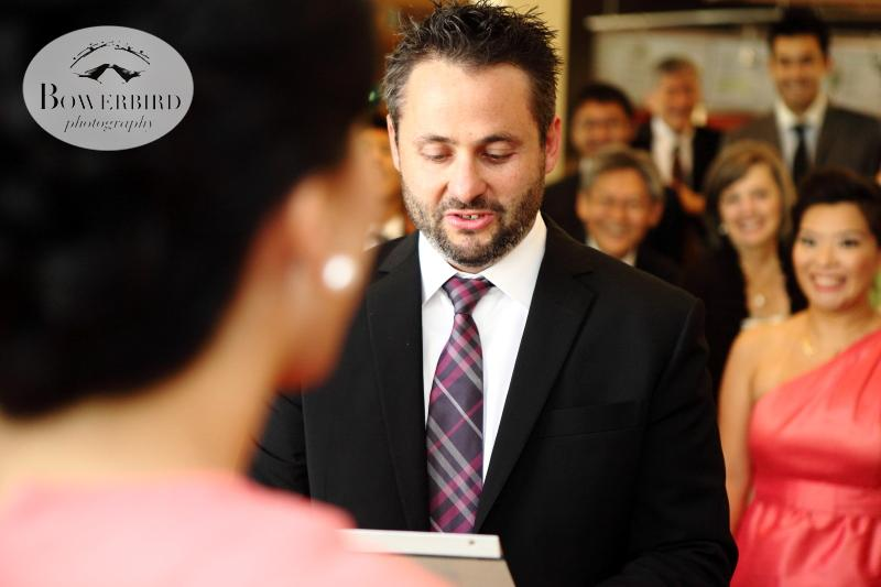 The groom reading to the bride in Mandarin, during their traditional Chinese tea ceremony. ©Bowerbird Photography 2013; St. Ignatius Church Wedding, San Francisco.