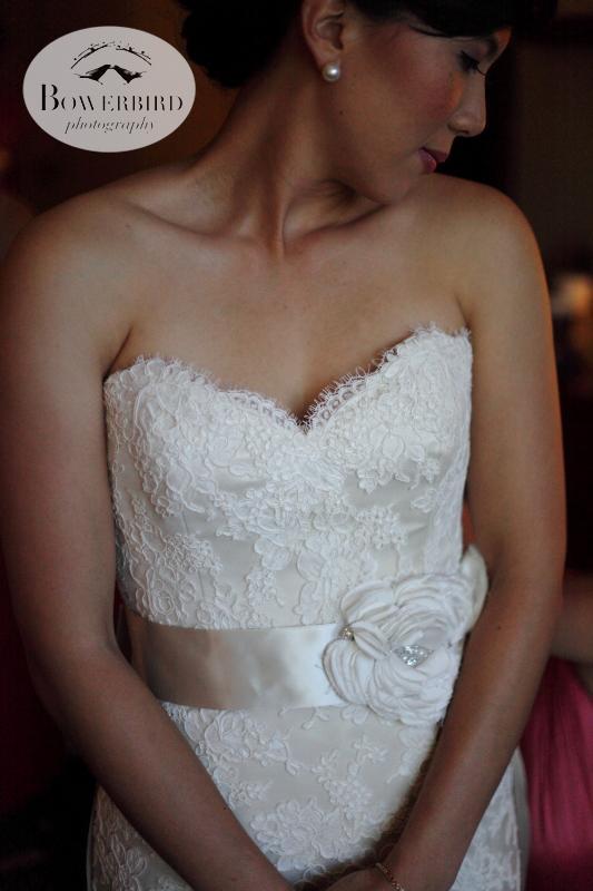 The bride in her gorgeous lace wedding dress. ©Bowerbird Photography 2013; St. Ignatius Church Wedding, San Francisco.