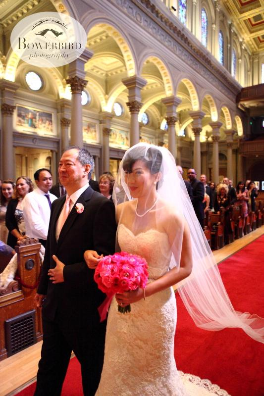 The bride and her father, walking down the aisle. ©Bowerbird Photography 2013; St. Ignatius Church Wedding, San Francisco.
