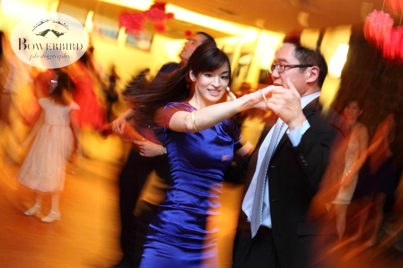 Guests dancing at the wedding reception. ©Bowerbird Photography 2013; Marin Art and Garden Center Wedding, Ross, CA.