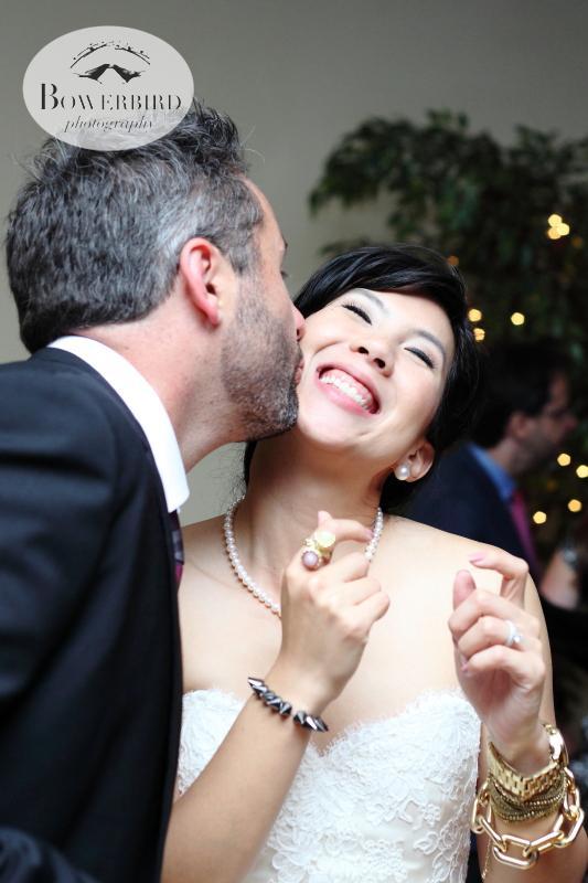 The groom kisses his bride on the dance floor. Adorable! ©Bowerbird Photography 2013; Marin Art and Garden Center Wedding, Ross, CA.