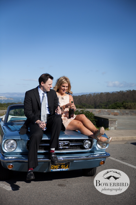 Opening the pink Veuve Clicquot champagne. © Bowerbird Photography 2013; Engagement Photography with vintage 1966 Mustang convertible, San Francisco.