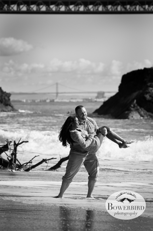 Playing in the ocean, just below the Golden Gate Bridge. © Bowerbird Photography 2013; Engagement Photography at Kirby Cove, Marin.