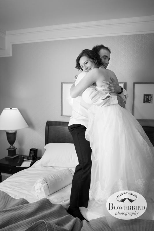 The bride and groom jumping on their bed after the wedding :) ©Bowerbird Photography 2013; Mark Hopkins Hotel Wedding, San Francisco.
