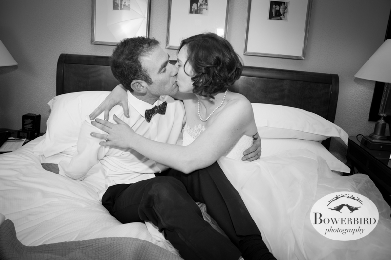 Night night love birds! The bride and groom share a kiss after their wedding. ©Bowerbird Photography 2013; Mark Hopkins Hotel Wedding, San Francisco.