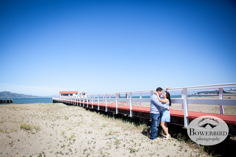 A kiss along the pier at Crissy Field. © Bowerbird Photography 2013; San Francisco Engagement Photo.