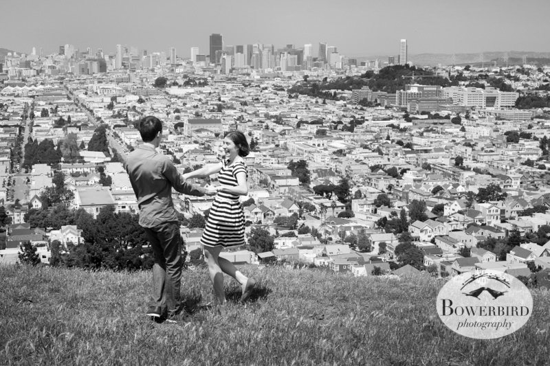 A fabulous San Francisco view from Bernal Hill while frolicking in the grass. © Bowerbird Photography 2013; San Francisco Engagement Photo.