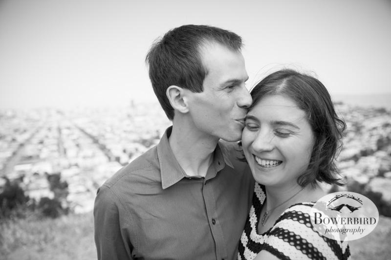 A kiss on Bernal Hill. © Bowerbird Photography 2013; San Francisco Engagement Photo.