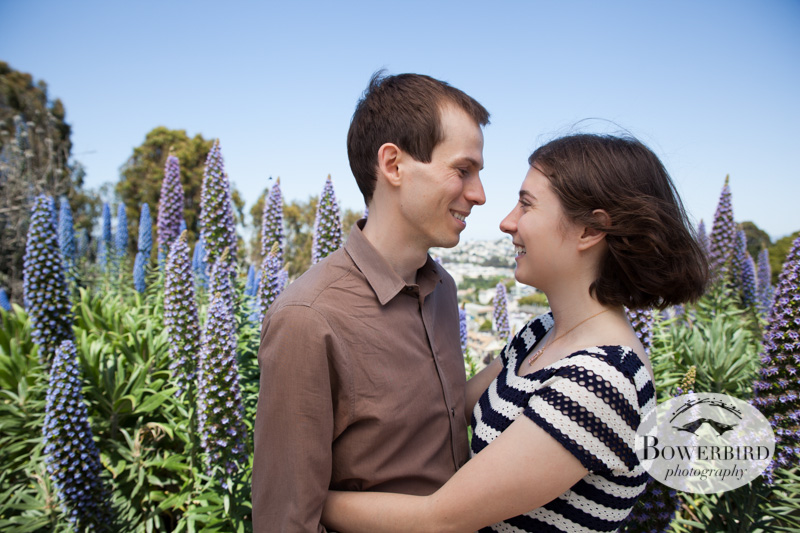 With the purple flowers on Bernal Hill. © Bowerbird Photography 2013; San Francisco Engagement Photo.