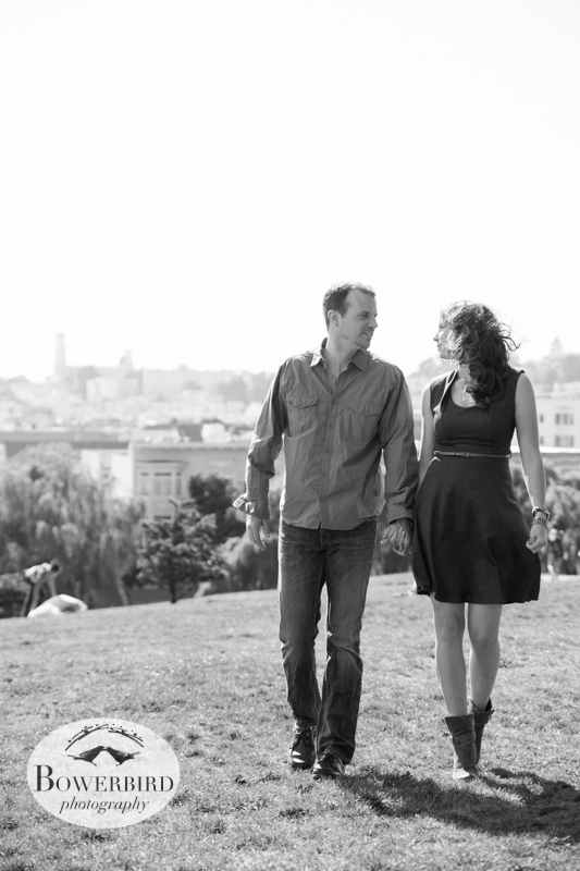 Walking in the park, hand-in-hand. © Bowerbird Photography 2013; Alamo Square, San Francisco Engagement Photo.