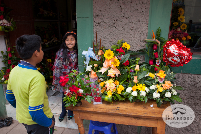 Boy flirts with flower girl on Mother's Day. © Bowerbird Photography 2013; Mother's Day in Cusco, Peru.