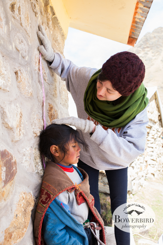 A child gets her measurements taken. © Bowerbird Photography 2013, Sacred Valley Health and Suny Brockport in Yanamayo, Peru.