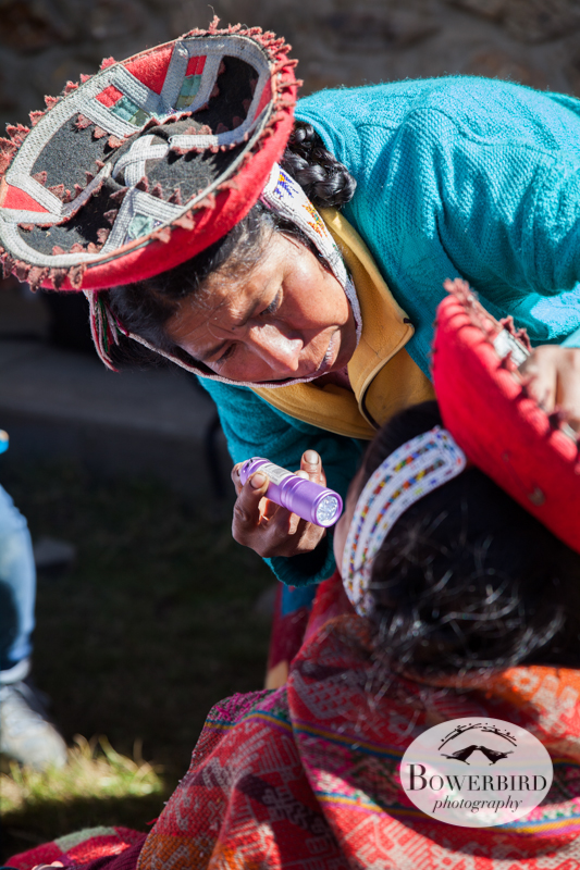 A local community health promoter checks a student's mouth for cavities. © Bowerbird Photography 2013, Sacred Valley Health and Suny Brockport in Yanamayo, Peru.