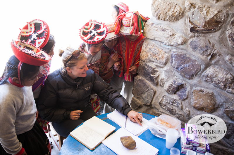 The children help Keri, of Sacred Valley Health, take stock of medical supplies. © Bowerbird Photography 2013, Sacred Valley Health and Suny Brockport in Yanamayo, Peru.