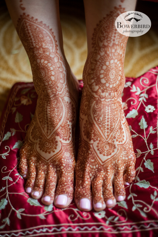 Wedding henna painted on the bride's feet with floral flourishes cascading from her legs to her toes.   © Bowerbird Photography 2013, South Asian Wedding at the San Francisco JW Marriott and Winery SF on Treasure Island