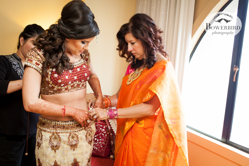 The bride's mom helps her get dressed. © Bowerbird Photography 2013, South Asian Wedding at the San Francisco JW Marriott and Winery SF on Treasure Island.