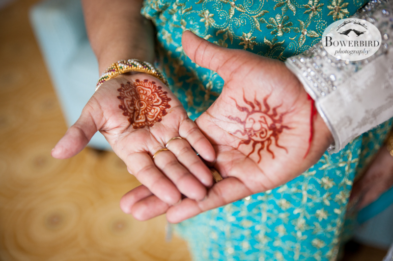 The groom's hand with the sacred om symbol in mehndi, with his mom's hand resting on top. © Bowerbird Photography 2013, groom's mehndi, South Asian Wedding at the San Francisco JW Marriott and Winery SF on Treasure Island.