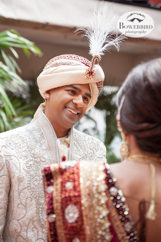 The groom looks upon his bride for the first time! Pretty soon they are going to be married!   © Bowerbird Photography 2013, First Look, South Asian Wedding at the San Francisco JW Marriott and Winery SF on Treasure Island.