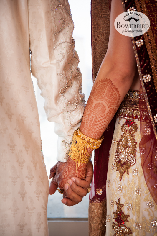 Holding hands.© Bowerbird Photography 2013, First Look, South Asian Wedding at the San Francisco JW Marriott and Winery SF on Treasure Island.