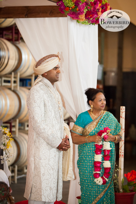 Avneesh and his mom watching the beautiful bride come down the aisle. © Bowerbird Photography 2013, South Asian Wedding at the San Francisco Winery SF on Treasure Island.