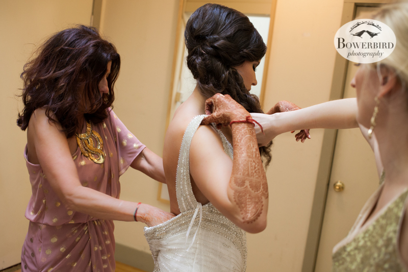 Angelica putting on her dress, with her mom's help. © Bowerbird Photography 2013, Wedding at the San Francisco Winery SF on Treasure Island.