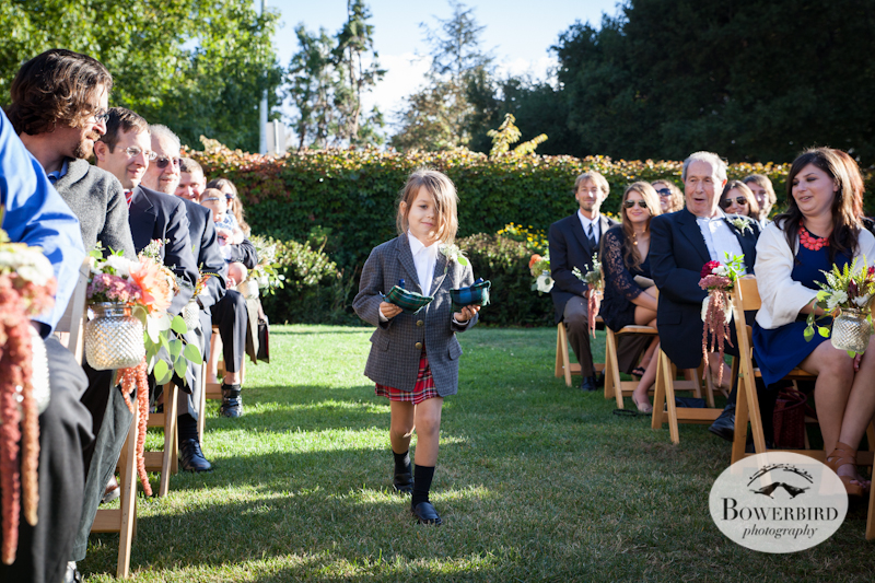 The ring bearer proudly sports his kilt, carrying the rings on custom, tartan pillows. Lucie Stern Community Center Wedding Photos.© Bowerbird Photography 2013