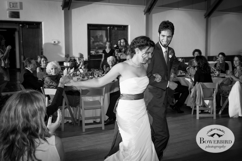 The bride and groom's grand entrance, includes some high-fives. Lucie Stern Community Center Wedding Photos.© Bowerbird Photography 2013